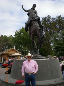 This is my grandpa in front of the statue at the round-up